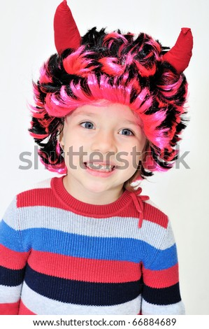 toothy smile of funny devilkin - stock photo