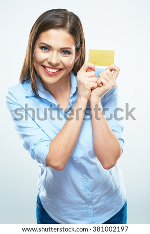 Toothy smiling young business woman hold credit card. White background isolated. - stock photo