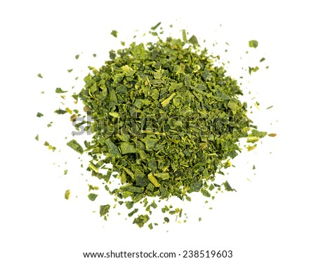 Top aerial view of loose leaf green tea isolated on white - stock photo