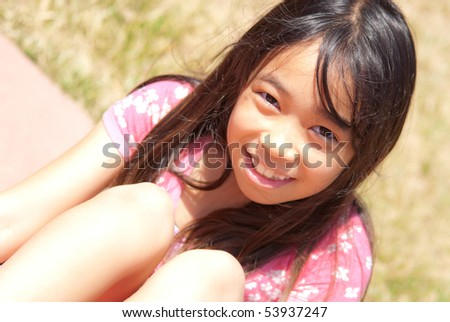 Top Angle Picture of Little Girl Smiling - stock photo