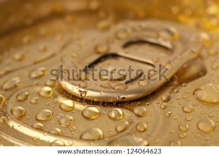 Top beer cans in drops close-up - stock photo