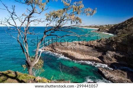 Top Cliff View of a Beautiful Ocean Coastline Overlooking the Sunshine Beach, Noosa National Park, Noosa Heads, Australia - stock photo