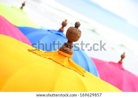 Top of a Colorful Beach Umbrella against the Sky - stock photo