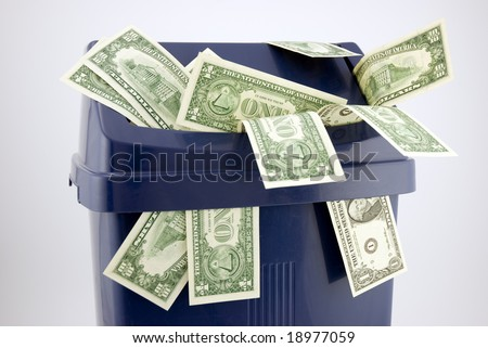 Top of a trash with one and ten dollar notes. - stock photo