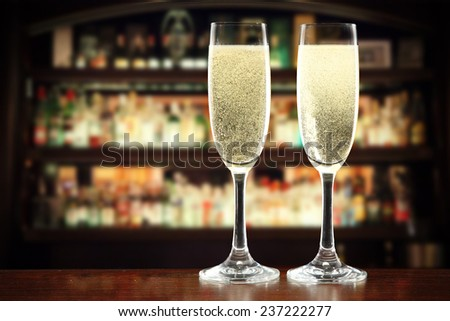top of bar in interior and two glasses of champagne  - stock photo