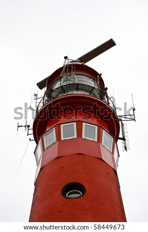 Top of dutch red lighthouse - stock photo