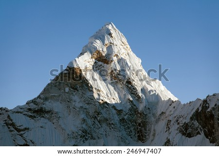 Top of evening mount Ama Dablam - way to Everest base camp - Nepal - stock photo