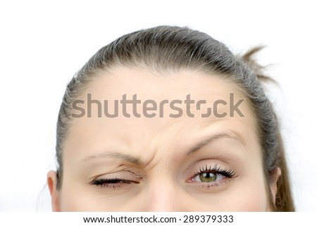 Top of female face looking frown, isolated on white - stock photo