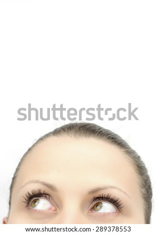 Top of female face looking up, isolated on white - stock photo