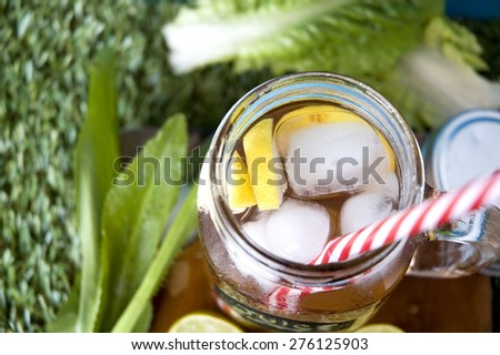top of lemonade mug with red straw - stock photo