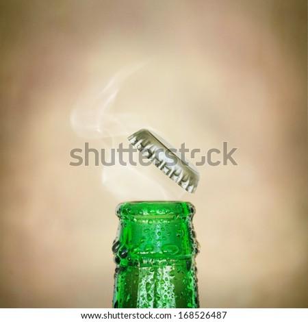 Top of open wet beer bottle - stock photo