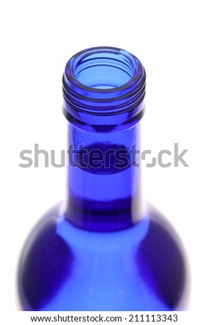 Top of opened blue bottle isolated on white background - stock photo