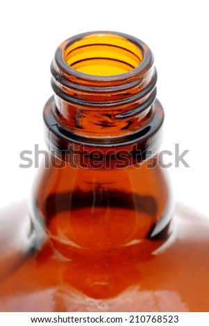 Top of opened brown bottle isolated on white background  - stock photo