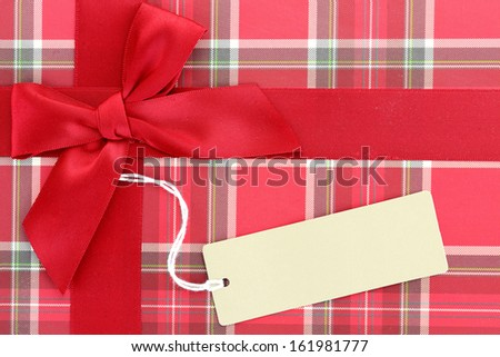 Top of present box with red ribbon - stock photo
