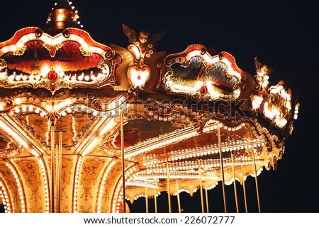 top of retro carousel at night - stock photo