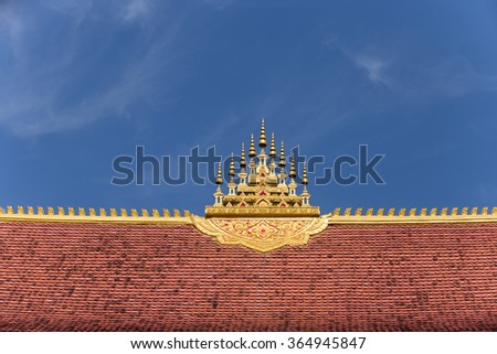 Top of roof worship in Buddha with blue sky , Chapel of Buddha in Laos - stock photo