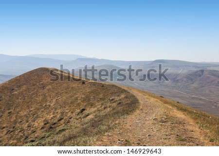 top of the mountain and blue sky - stock photo