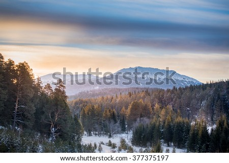 Top of the mountain at sunrise. Ural mountain.Iremel. Majestic landscape glowing by sunlight in the morning. Dramatic and picturesque wintry scene.Beauty world. IHappy New Year! - stock photo