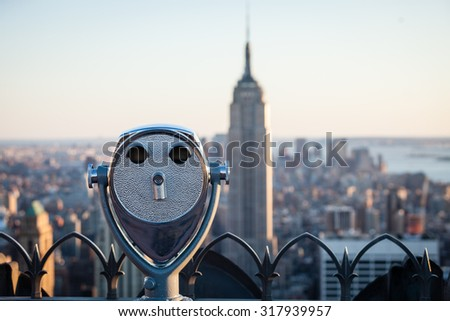 top of the rock observation deck with out of focus empire state building in the background - stock photo