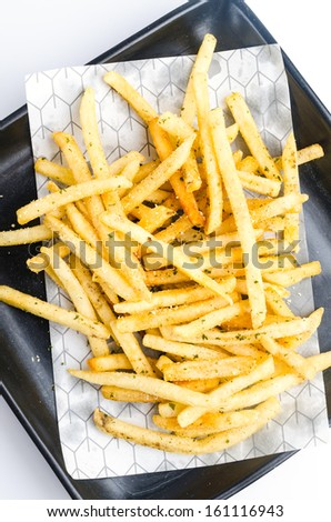 Top of view French fried in black dish on white background - stock photo