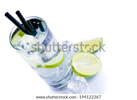 top of view of cocktail glass with ice and lime slice isolated on white background - stock photo