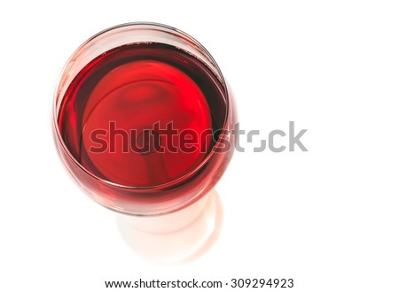 top of view of red wine in the glass isolated on white background - stock photo