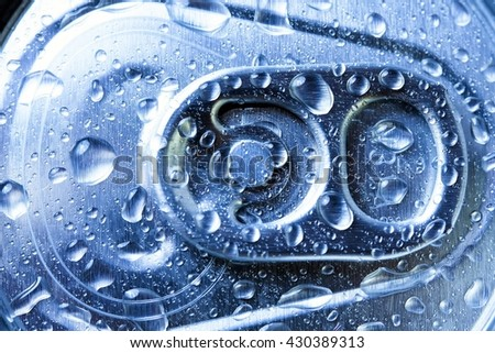Top part of beer cans with water drops, close up view - stock photo