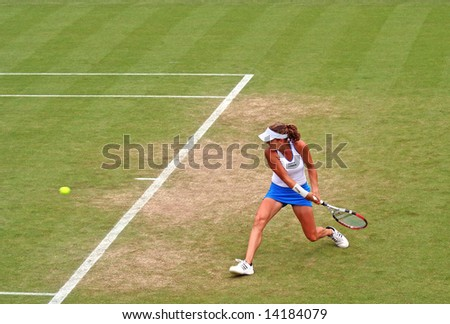Top Polish woman tennis player Agnieszka Radwanska in action - stock photo