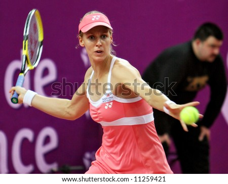 Top Russian tennis player Elena Dementieva hits forehand during her match at Open Gaz de France. Stade de Coubertain, Paris, France. February 2008. - stock photo