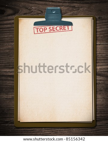 Top secret document on old wooden table. - stock photo