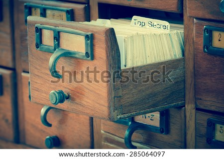 top secret file in wooden drawer - stock photo