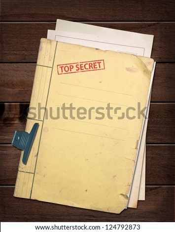 top secret file on wooden table. - stock photo