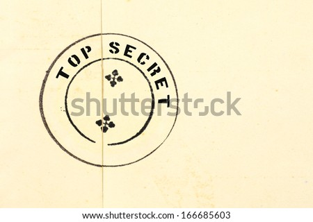 Top secret ink stamp on a grungy retro brown envelope seal.  - stock photo