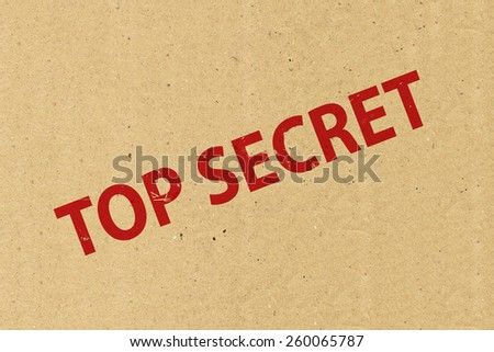 Top secret stamping on brown paper - stock photo