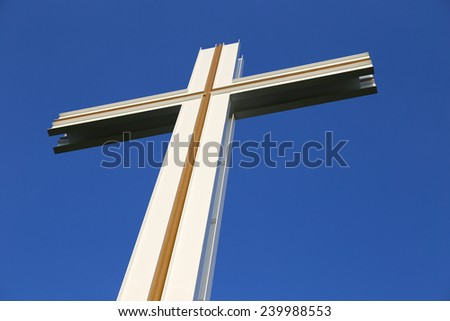 Top section of The Papal Cross in Dublin Phoenix Park against a deep blue sky - stock photo