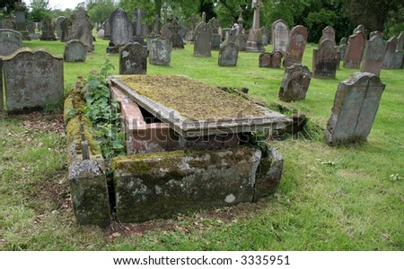 Top stone has been move from the grave - stock photo