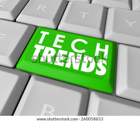 Top Trends words on a green computer keyboard button to illustrate top, best or most popular modern computer programs, software, hardware or devices - stock photo