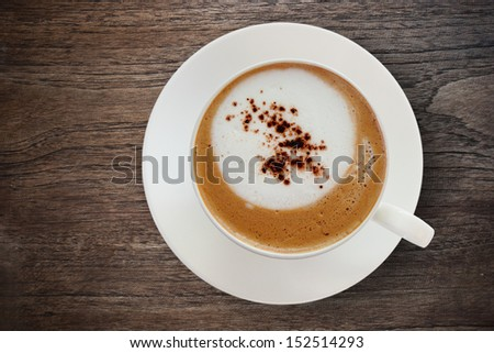Top view a cup of coffee with some bubbles on wood texture.  - stock photo