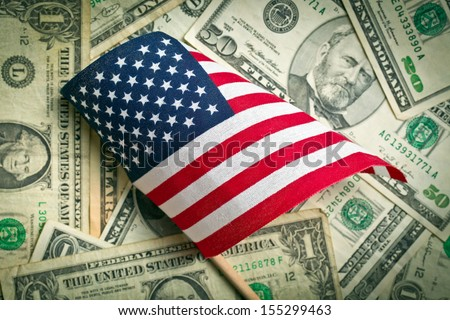 top view american flag on us dollars background - stock photo
