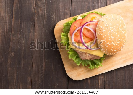 Top view BBQ hamburgers on cutting board on wooden background - stock photo