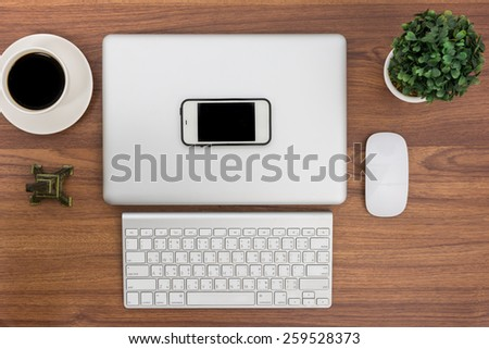 Top view close laptop or notebook workspace office on wooden table - stock photo