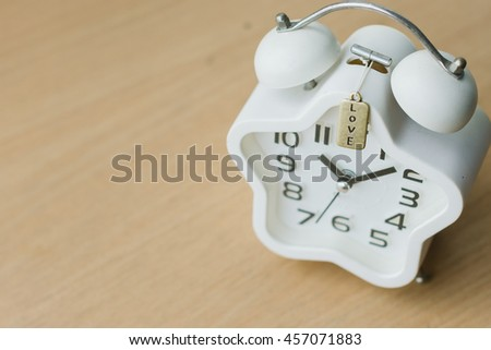 Top view close up of white clock on the wood table - stock photo