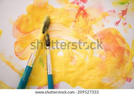 Top view closeup portrait of paintbrushes and paint on the desk - stock photo
