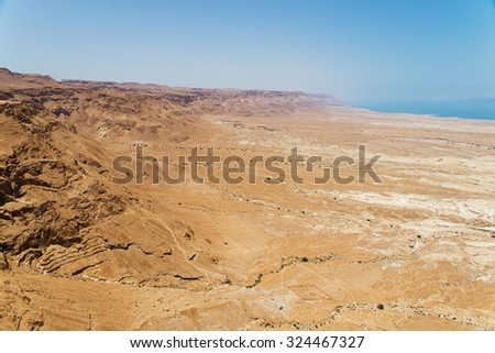 Top view from Masada fortress to the Judaean desert and the Dead Sea - stock photo