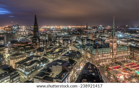 Top view HDR shot of Hamburg town hall with christmas market - stock photo