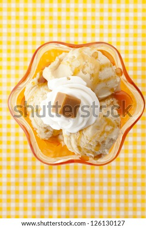 Top view image of cheese ice cream on a yellow striped background - stock photo