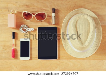 top view image of woman accessories , different objects on wooden background. - stock photo