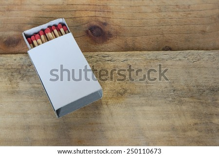 top view matchbox on wood - stock photo