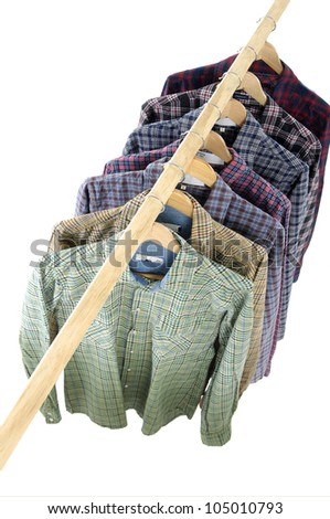 Top view Men's different sleeved plaid cotton on a wooden hanger - stock photo