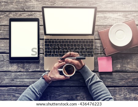 Top view mockup - laptop and tablet pc with cup of coffee. Clipping paths included. - stock photo